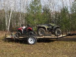 Use as a utility trailer, this one has three 4 wheelers.