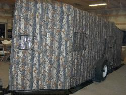XD3 Camouflage Trailer with screen porch extension.